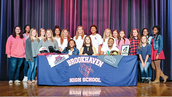 Submitted photo/Tia Bussey, Jada Henderson and Macy Ziskin signed letters of intent to play softball at the community college level Tuesday. They are surrounded by teammates and coaches at the signing ceremony.