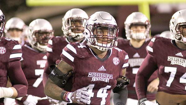 Leo Lewis (44) helped MSU beat Ole Miss Saturday.