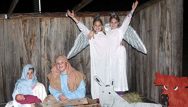 Daily Leader file photo / The New Sight Baptist Church's live nativity will open for viewing Dec. 16-18 from 5:30 to 8:30 p.m., scenes of Jesus' life will be depicted. Emily Douglas (left) and Eli Cupit were Mary and Joseph in a past performance. Lili and Saide Cupit were angels that year. Scenes of Jesus' life will be depicted.