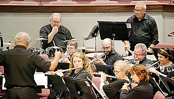 Photo by Donna Campbell/Leroy Smith leads members of the Ole Brook Wind Symphony in a fall concert at Easthaven Baptist Church. Their winter concert will be Dec. 13 at the church and Dec. 15 at State Theatre in McComb. Both shows, which are free to the public, begin at 7 p.m.