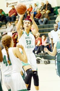 Photo by Dylan Rubino/ Megan Gerald (23) stops in the lane for a jumpshot against Salem.
