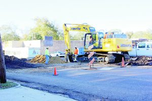 Photo by Alex Jacks/Greenbriar, a local construction company, is replacing a water line on Court Street for the city.