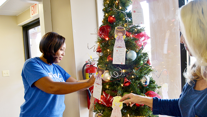 Photo by Orionna Brumfield/Deaconess Hospice manager Tenesia Wilson (left) and palliative care representative Rhonda Brown decorate the business' Angel Tree Friday. This is Deaconess' first year to participate in the program, which is sponsored by the Salvation Army. Angels are available for adoption at their new location at 103 Whitebrook Drive.