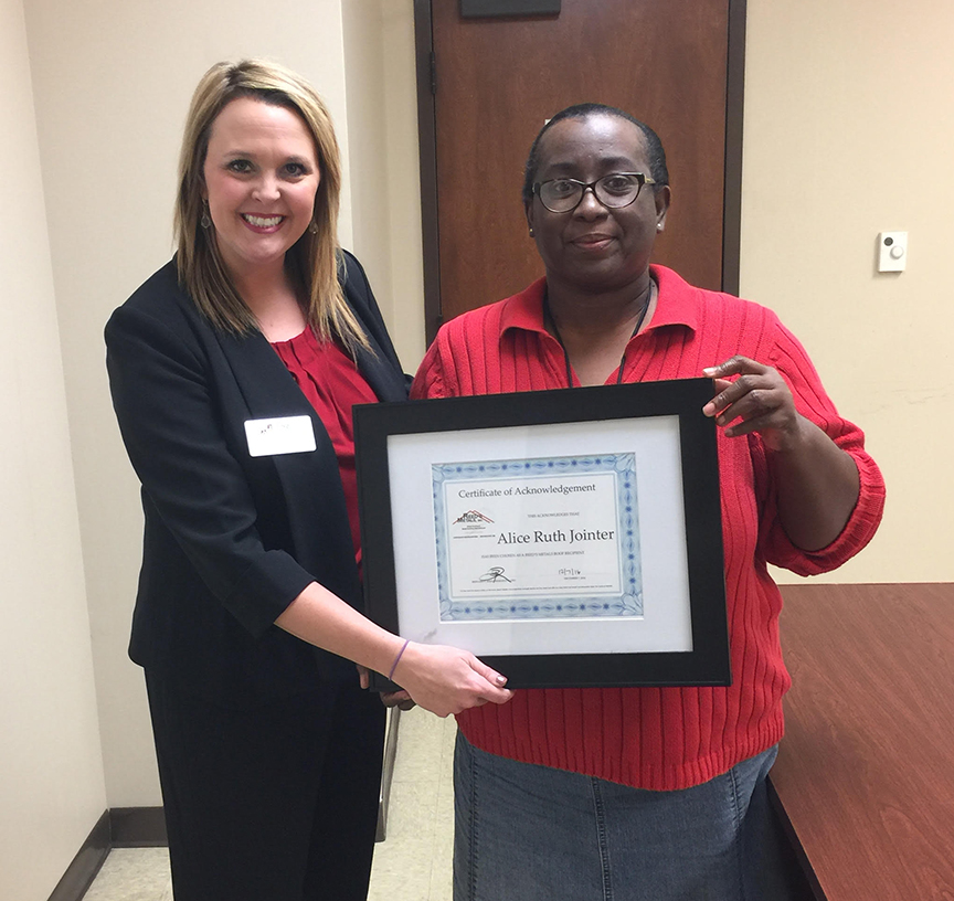 Photo submitted/Jessica Breazeale with Reed's Metals congratulates Alice Ruth Jointer, of Wesson, with a certificate acknowledging her contest win. She'll receive a new metal roof for her home.