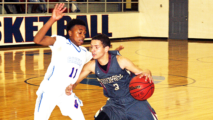 Photo by Tracy Fischer/Trevor Freeman (3) is guarded by JD Allen (11) in the Wesson vs. Enterprise game Friday.