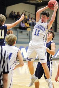 Photo by Sherlyn Evans/Colton Watson (11) goes up for the rebound Saturday afternoon against Prentiss.