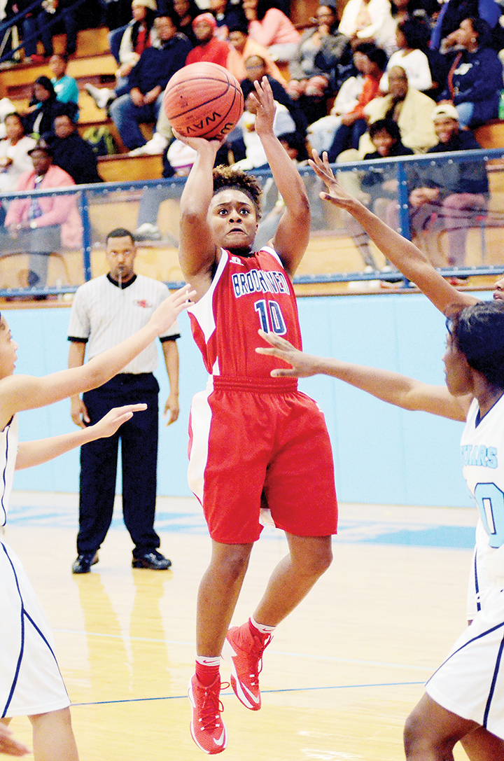Photo by Dylan Rubino/Shania Harris (10) pulls up for the jumpshot Friday against North Pike.