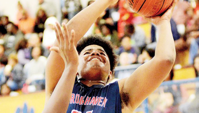 Photo by Dylan Rubino/Jashawn Perkins (24) tries to convert the putback Friday against North Pike.