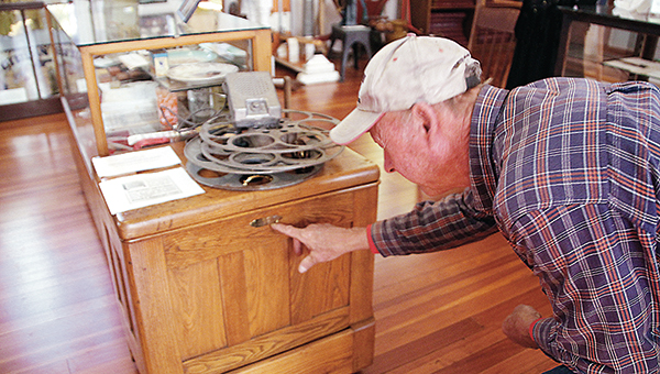 Photo by Alex Jacks / Harrell Montgomery examines an antique chest at the Lincoln County Historical Museum.