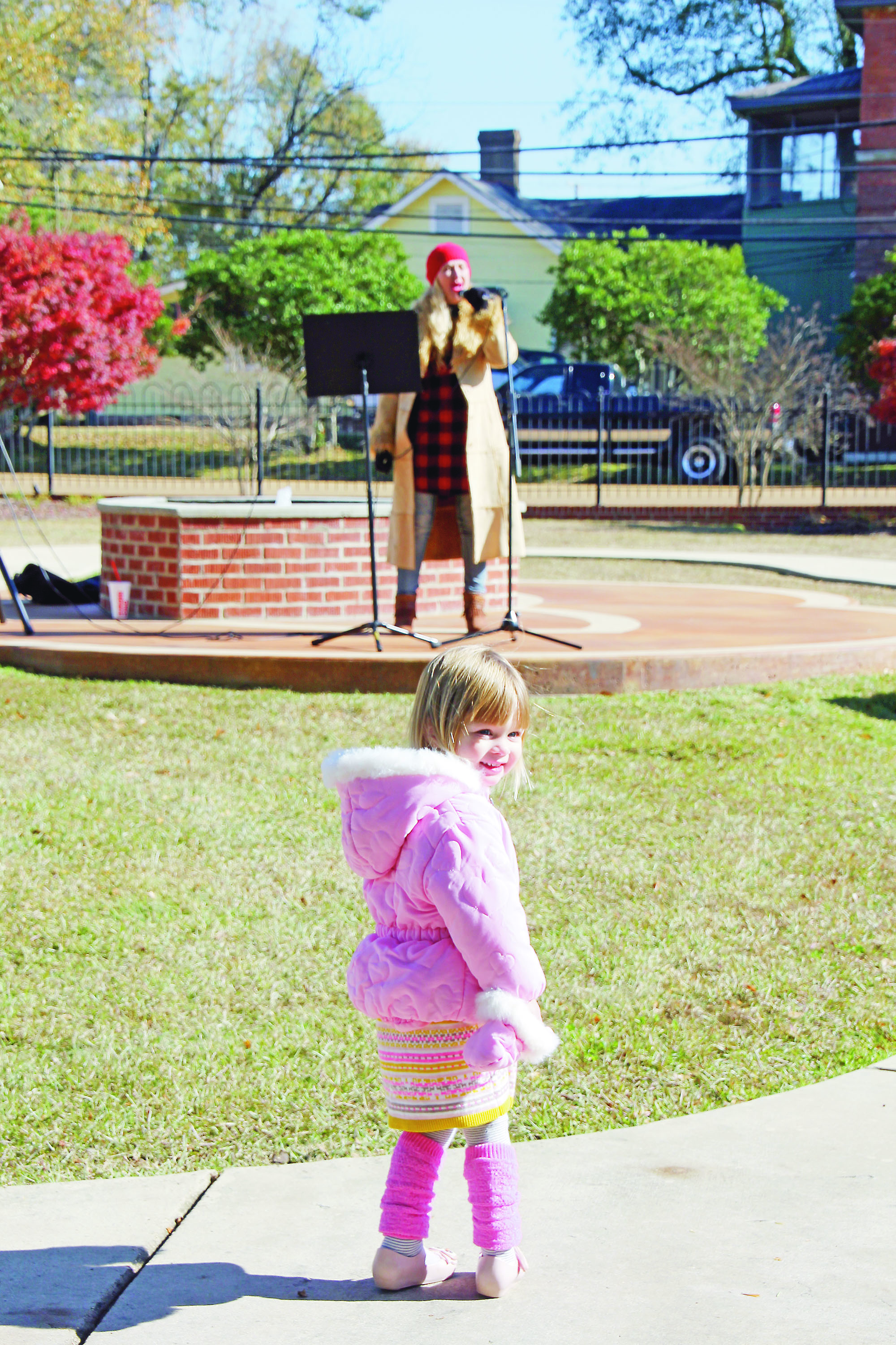 """Photo by Alex Jacks/People of all ages enjoyed local vocal music teacher Ashley Dunaway Jackson's performance in Trinity Park Thursday as part of """"Christmas Music and Art in Trinity Park."""""""
