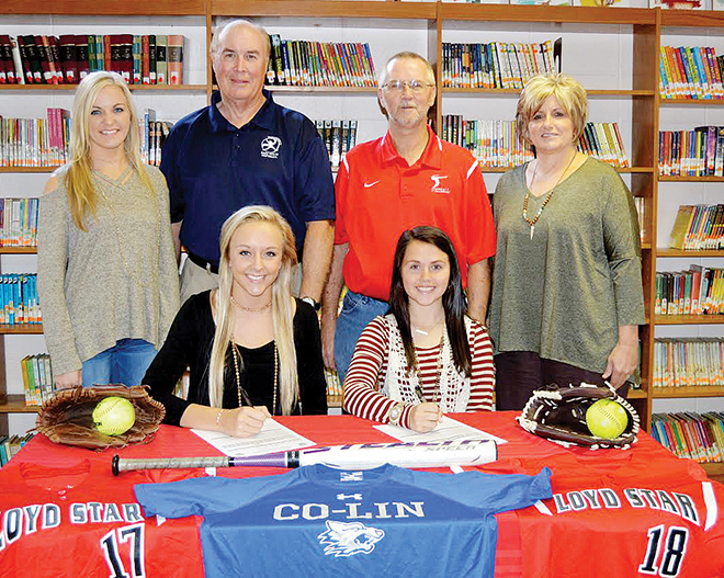 Photo by Chris King /Makenzie Smith and Abigail Thornton (bottom row) are joined by assistant coach Brooke Keene, pitching coach Bobby Waterbury, Loyd Star athletic director Billy Vaughn, and head fast pitch coach Jan Delaughter (top row) as they sign to Co-Lin.