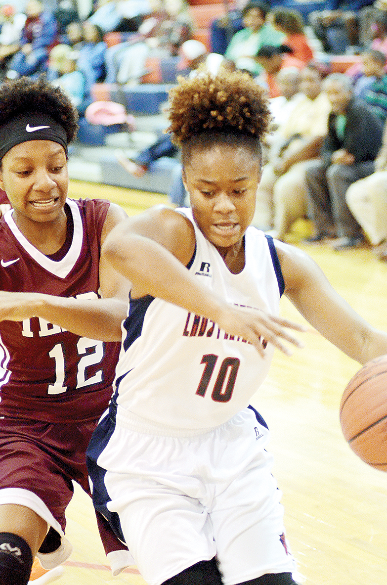Photo by Dylan Rubino/Shania Harris (10) drives against a defender in a recent game.
