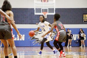 Photo by Co-Lin/The Lady Wolves' Brittany Rose tries to get past a Jones player Monday night.