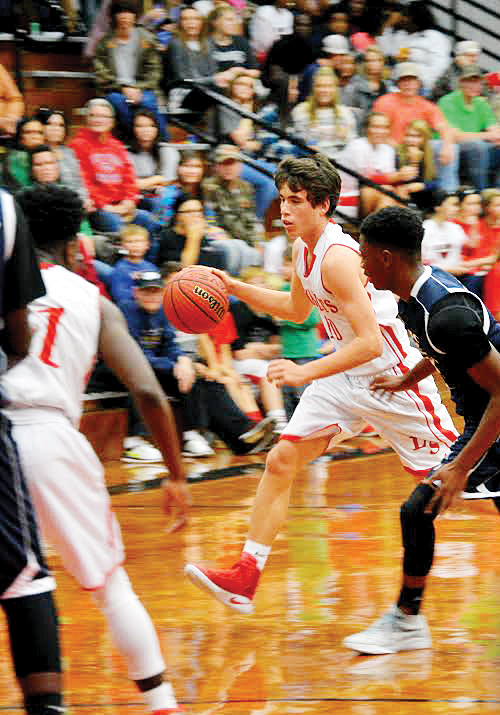 Photo by Lydia King/Loyd Star's Cade Hodges (10) drives the ball down the lane in win against Bogue Chitto Friday night 69-54.