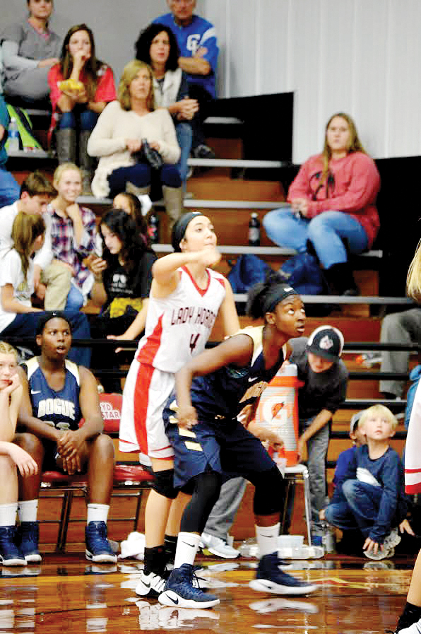 Photo by Lydia King/Caylee Grace Yarborough makes a three-pointer in win against Bogue Chitto Friday night 65-25.