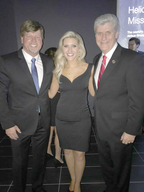 Photo submitted/Bernie Reed (left) attends an inaugural party Wednesday with Miss Mississippi Laura Lee Lewis and Gov. Phil Bryant.