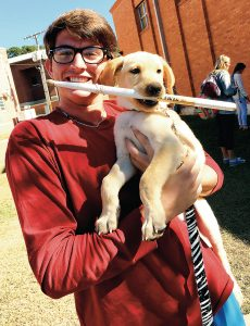 Phi Theta Kappa at Copiah-Lincoln Community College hosted a Pet Therapy Day in 2016. Reid Butler was among those who participated.