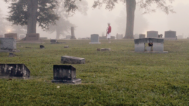 """Photo submitted/Betty Ann Perkins walks among the headstones in Rosehill Cemetery in Brookhaven for her acting debut in """"Don't Come Around Here,"""" a film shot in Bogue Chitto and Brookhaven and produced and co-written by Travis Mills. Mills also wrote, directed and produced """"Porches and Private Eyes."""""""